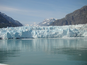 One of the magnificent ice glaciers in Glacier Bay, Glacier National Park -- the height of a 30-storey building it drops tons of ice every hour as it 'calves' into the water beside it.
