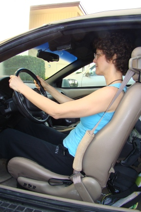 Photo #1 - Poor posture caused by car seat that inclines back.