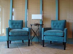 Illustration of the 2010 color of the year, turquoise, on two velvet transitional chairs and flat low VOC Aura Benjamin Moore wall paint behind chairs.  Photo by Betsy Rist.