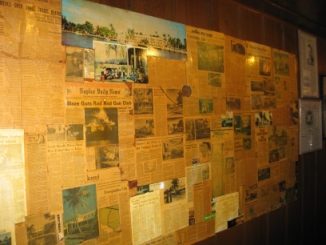 The wall of newspaper articles, papered with history. Photo by Jeane Brennan.