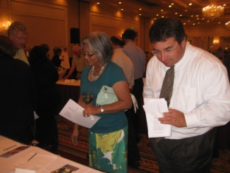 Mr. And Mrs. Steve Thompson (City Manager) checking out items at Hilton's Haiti Fundraiser. (Photo by Jeane Brennan)