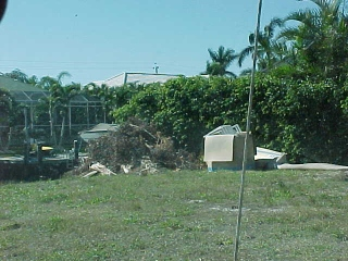 Old furniture and trash dumped on a vacant lot. (Photo by Eric Wardle)