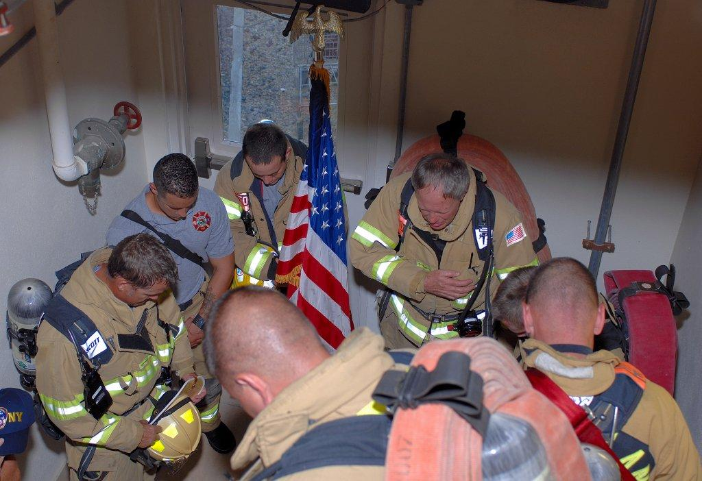Marco Island Fire Department members bow their heads in remembrance of the heroes and victims of 9-11.