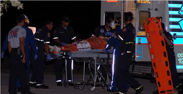 MIFD place victim in ambulance.