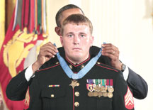 Receiving the medal of honor.