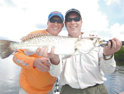 Brian and Tim with a fat mid winter Trout. PHOTOS BY CAPT. RAPPS/COASTAL BREEZE NEWS
