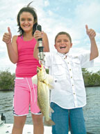 Angelina and Joey Scalogna with a Trout.