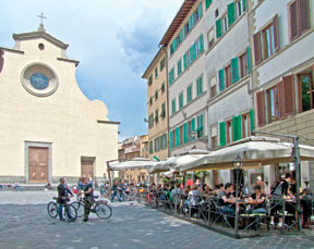 Piazza di Santo Spirito in the Oltrarno section of Florence is frequented by both tourists and locals.