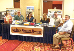 Ivette and Andy Delgado (second from left) with their Andrew Hunter Homes team.