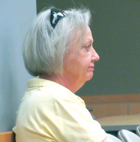 Barbara Confer, Coldwell Banker agent representing Bank of America listens to Code Enforcement Board consider mitigation options for a foreclosed property at 1774 Hummingbird Court.
