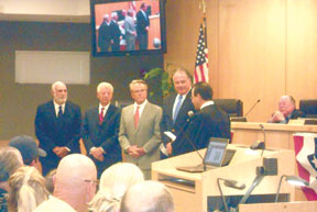 Larry Sacher, Amadeo Petricca, Larry Honig, and Ken Honnecker are sworn in as new City Council members on November 12. PHOTOS BY DANIELLE DODDER/COASTAL BREEZE NEWS