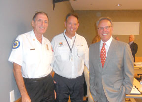 Fire Chief Mike Murphy, Community Affairs Director Bryan Milk, and Councilor Larry Honig.