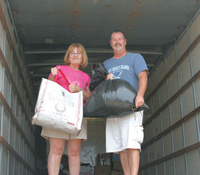 Teresa Groves and Paul Cantwell load the first batch of donations to Sandy victims.