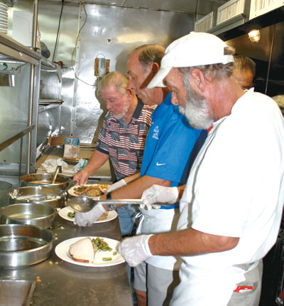Tom Brennan, Mike Brennan and Tim Collins served up the meals.