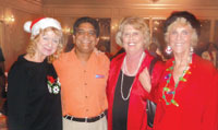 Hilton General Manager, Mac Chaudhry, welcomes Chamber members at their annual After 5 for Christmas Island Style.