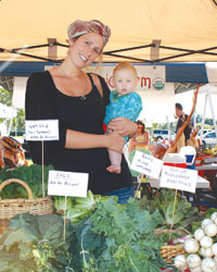 Shaina Muth and her daughter Amelie man the Inyoni Farms booth at Veterans Park.