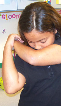 """A student in Ms. Peña's 5th grade class demonstrates coughing into your elbow to keep your germs to yourself."" SUBMITTED PHOTOS"