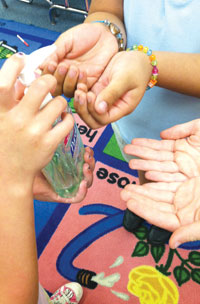 """Little hands in Ms. Schulman's 1st grade class wash up."""