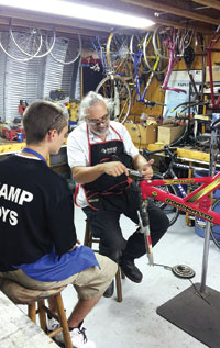 The Swamp Boys learn how to refurbish bikes from the experts. A total of 50 bikes were donated to Manatee and Everglades City Schools in the past few months. SUBMITTED PHOTO