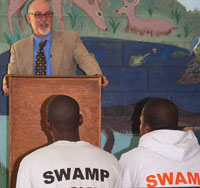 "Executive Director Ron Boyce addresses the Swamp Boys at graduation. ""They'relike my kids,"" he says. PHOTO BY NATALIE STROM"