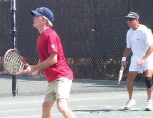 Walt Lewis (red shirt) andRick Eichman of the Island Club.