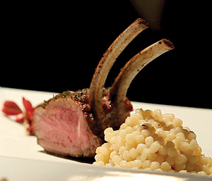 CaterMasters served its signature rack of lamb with black truffle couscous and micro carrots at the 2013 Southwest Florida Wine and Food Festival.