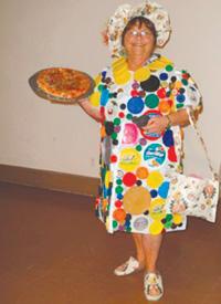 Judy Daye, models her homemade creations at UCMI Bargain Basket fashion show.