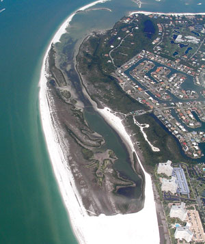 Tigertail Beach and Lagoon with the former Pelican Island now incorporated into Marco Island and almost invisible lying north of South Seas condominiums and extending into the western part of Hideaway Beach.