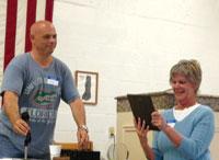 Joanie Fuller receives her plaque.