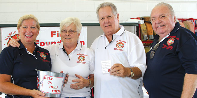 Foundation President Dianna Dohm and Vice President Roy Birkeland congratulate Barb and Lou Prigge (center).