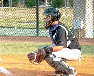MIA catcher Andrew Delgado (13) signalsthe pitcher.