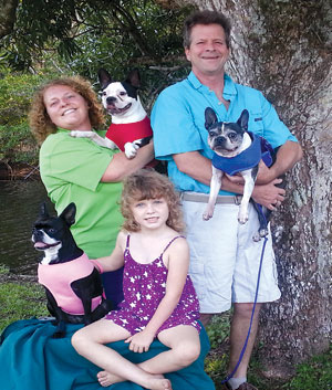 The family behind the man: Ken, his wife Eva, daughter Olivia and their three Boston Terriers, Bully, Racer and Lulu.