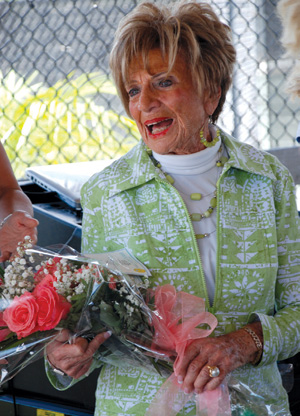 Ms. Dottie gushes with gratitude as she receives flowers from the Marco Island Area Chamber of Commerce.