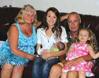 Michael and Nancy with their three grandchildren,from oldest to youngest, Amanda, Kayleen and Michael.