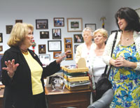 Donna speaks with guests in her office.