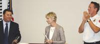 Captain Chris Crossan, right, and Carole Roberts, congratulate Bid Bakkar as the 2013 Galahad Award Recipient.