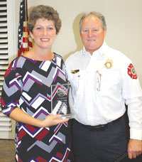 Cheryl Toth was given the Galahad Award for Education. She stands with Division Chief Don Jones who has worked on educating MICMS students with Toth for many years.