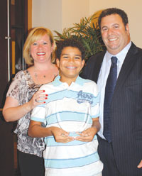 Bid Bakkar with wife Jennifer and son Lane, who proudly holds his father's award.