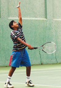 Tennis serve: tossing the  ball before hitting it. SUBMITTED PHOTO