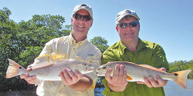 Tom and Chris with twin Redfish.