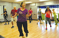 This Zumba class is all smiles with instructor Michelle Jordan. PHOTOS BY MELINDA GRAY