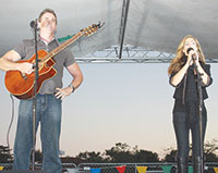 Mike and Mary Jo O'Regan perform on the Kriger Orthodontic stage.