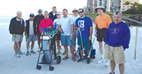Katie O'Hare of the Marco Island Chamber of Commerce hands out trash grabbers to the volunteers.