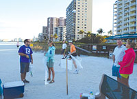 The Board of Realtors' Young Professionals gather for the beach clean-up.
