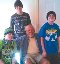 Butch enjoyed spending time with his three grandsons.