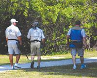 Members of Paradise Gun Club stroll to their next shooting station.
