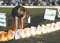 Luminarias lit the field.