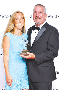 Linda and Steven Henell pose with the company's Aurora Award. SUBMITTED PHOTO
