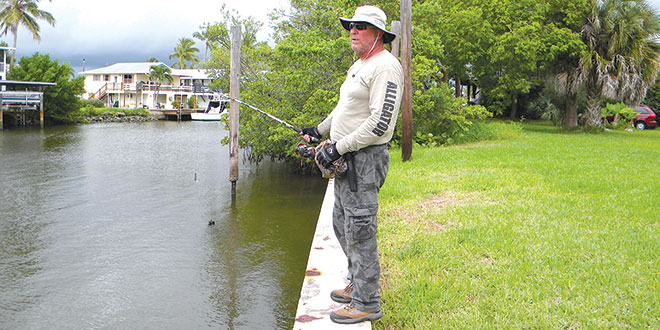 'Ray the Trapper' attempts to snag the Goodland gator, who made no appearance that day.  PHOTOS BY MELINDA GRAY
