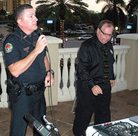 Emilio Rodriguez, a community service officer with the Marco Island Police Department, addresses attendees at BMO Harris Bank's Holiday Spectacular.